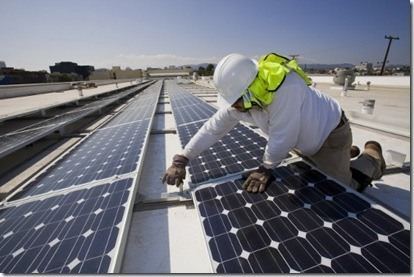 Installation of Grid-tied solar array on roof of Big Blue Bus facilities, Santa Monica, California, USA
