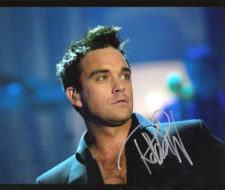 China será pavimentada con discos de Robbie Williams